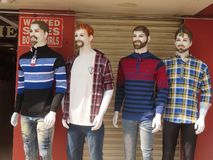 Shop Dummies. 4 hideous shop dummies outside a shop in Mysore. Painted faces which look ridiculous royalty free stock images