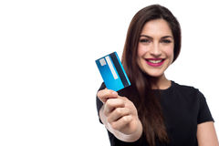 Shop easy with credit card !. Cheerful woman showing her credit card to camera Stock Images