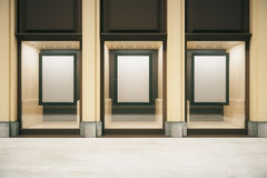 Shop exterior with blank frames. In showcase. Mock up, 3D Rendering Stock Photos