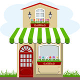 Shop front with awning. Little cute retro house and store, shop or boutique with green awning Stock Photos