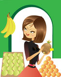 Shop girl. The young shop-girl   holds pineapple in her hands Stock Images