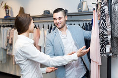 Shop girl helping client at boutique Royalty Free Stock Photos