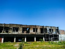 Shop house under blue sky. Shop house ruin in makassar under the blue sky Stock Images