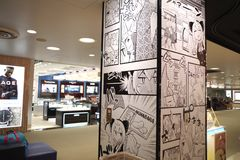 Shop in Narita Airport, Tokyo Japan. Shop inside Narita Airport showing manga on columns, Tokyo Japan Stock Photography