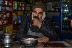 Shop Keeper in Pakistan. The man is looking life the tired of the life at Pakistan`s famous food street in Lahore Stock Photography