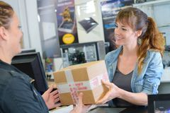 Shop keeper receiving delivery. Shop stock image