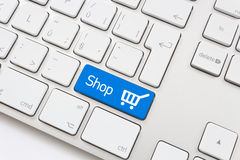 Shop key with trolley icon Stock Photo