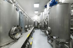 Shop with large metal tanks, modern production of beverages. Food industry stock photography