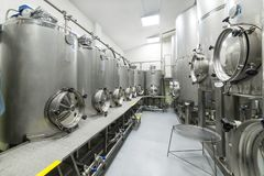 Shop with large metal tanks, modern production of beverages. Food industry stock image