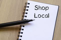 Shop local write on notebook Royalty Free Stock Photography