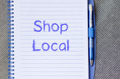 Shop local write on notebook Royalty Free Stock Photo