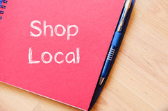 Shop local write on notebook Stock Photo