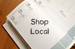Shop local write on notebook Stock Photography