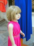 Shop Mannequin, Young Girl in Pink Dress stock photo
