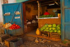 Shop, market with vegetables: cabbage, tomatoes. pumpkin, pepper, garlic. Trinidad, Cuba. royalty free stock photos