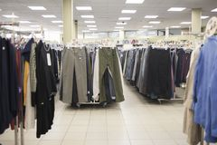 Shop men`s trousers. In the store Stock Photography