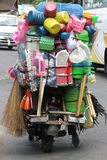 Shop on Motorcycle. A mobile shop selling household items in Ubud. The motorcycle is almost hidden by the items being sold royalty free stock photography