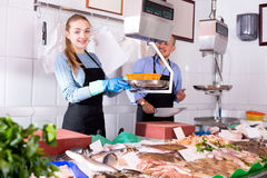 In shop offering fresh fish mature seller Royalty Free Stock Photos
