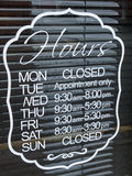 Shop opening hours. Shop or store opening hours on window Stock Image