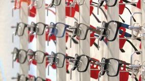 Shop optics ,lenses and eyeglass frames stock footage