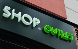 Shop Outlet. White and green signboard for outlet shop Stock Photo