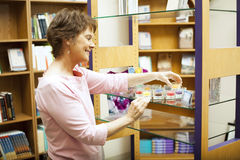 Shop Owner Arranges Display Royalty Free Stock Photo