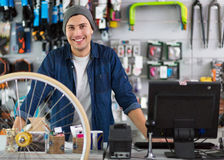 Shop owner in bicycle workshop Royalty Free Stock Photos