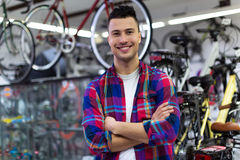 Shop owner in bicycle workshop Royalty Free Stock Images