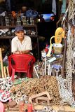 Shop owner, Ho Chi Minh City, Vietnam. Man sitting on red chair selling chains in Ho Chi Minh City, Vietnam Stock Photo