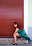 Shop owner opens the shutters on the Windows 1. Girl sat down and bared their legs Royalty Free Stock Image