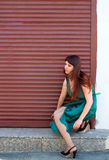 Shop owner opens the shutters on the Windows 3. Girl sat down and bared their legs Royalty Free Stock Photography