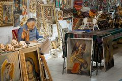 Shop owner reading newspaper in a souvenir store,. Peru 2011-06-19 11:43:23 AM stock photos