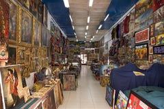 Shop owner reading newspaper in a souvenir store,. Peru 2011-06-19 11:43:30 AM stock photos
