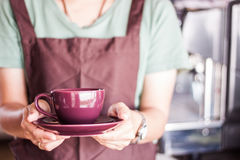 Shop owner serving freshly brewed coffee Stock Photos