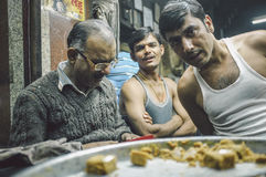 Shop owner and workers Stock Images
