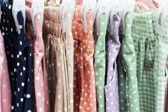 Shop pants hanging on a rack market. Stock Images