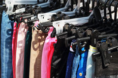 Shop pants hanging on a rack market. Stock Image