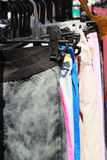 Shop pants hanging on a rack market. Stock Photo