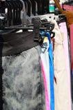 Shop pants hanging on a rack market. Stock Photo