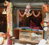 Shop seller waiting in her decoration shop in Asan market, Kathmandu Stock Image
