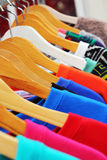 Shop shirts colorful fabric hanging on a rack. Royalty Free Stock Photography