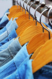 Shop shirts colorful fabric hanging on a rack. Shop shirts colorful fabric hanging on a rack Stock Photos