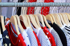 Shop shirts colorful fabric hanging on a rack. Stock Image