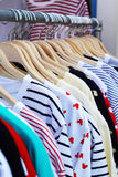 Shop shirts colorful fabric hanging on a rack. Royalty Free Stock Images