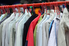 Shop shirts colorful fabric hanging on a rack. Royalty Free Stock Image