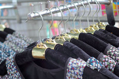 Shop shirts colorful fabric hanging on a rack. Stock Photos