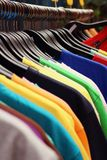 Shop shirts colorful fabric hanging on a rack. Stock Images