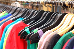 Shop shirts colorful fabric hanging on a rack. Shop shirts colorful fabric hanging on a rack Royalty Free Stock Photos