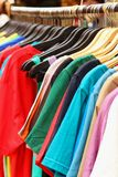 Shop shirts colorful fabric hanging on a rack. Stock Photography