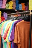 Shop shirts colorful fabric hanging on a rack. Stock Photo